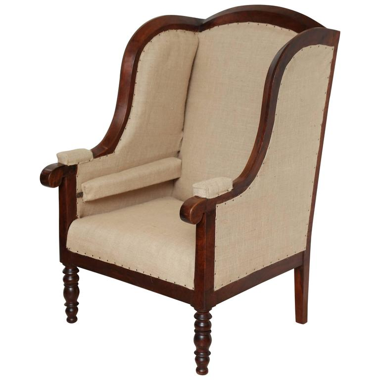Early 19th Century French Walnut Upholstered Wing Chair