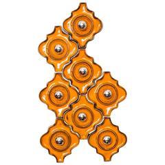 Set of Eight Orange Ceramic Interlocking Sculptural Wall Tile Sconces