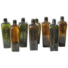 Set of 8 Multi-Color Gin Glass Bottles from Mid-Century Germany