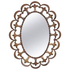 Hollywood Regency Antique Oval Mirror with Sculptural Brass Frame