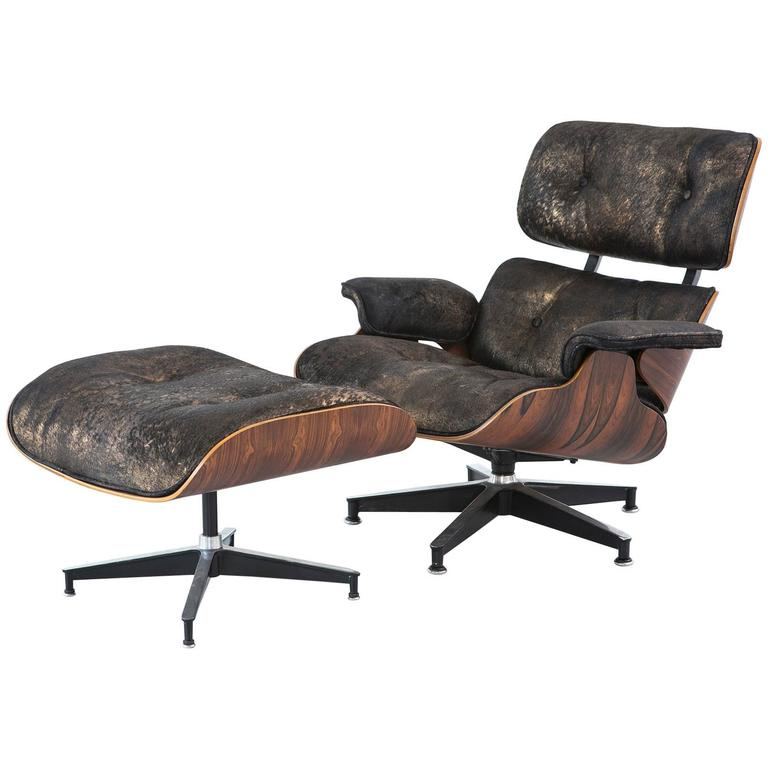 Rosewood Eames Lounge Chair And Ottoman Reupholstered In Acid Washed Cowhide