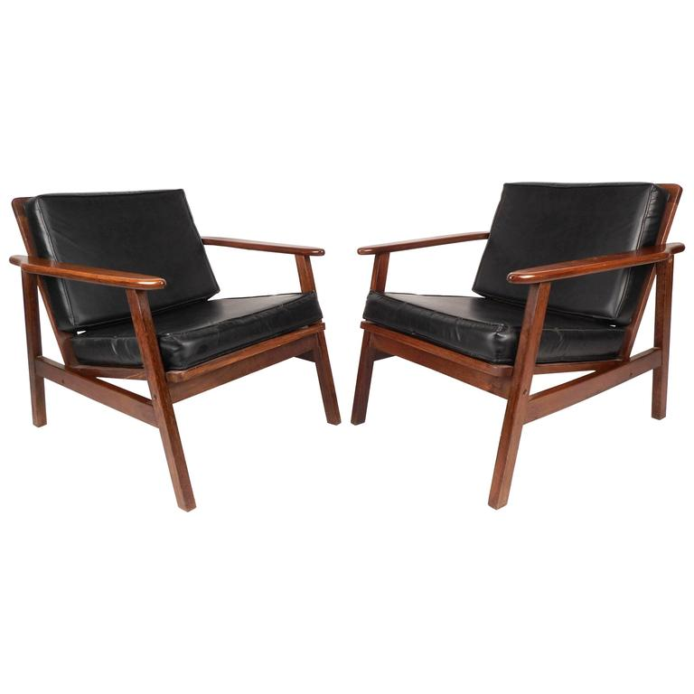 this pair of mid century modern walnut lounge chairs is no longer