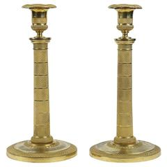 Early 19th Century Pair of French Empire Period Ormolu Candlesticks, circa 1810