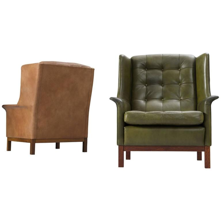 Arne Norell Pair of High Back Chairs in Patinated Green and Cognac Leather