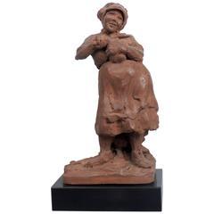 """Woman Slicing Bread"" Sculpture by Ramon Lago"