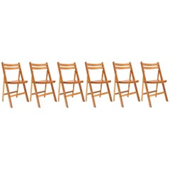 Mid-century modern vintage wooden stackable folding chairs