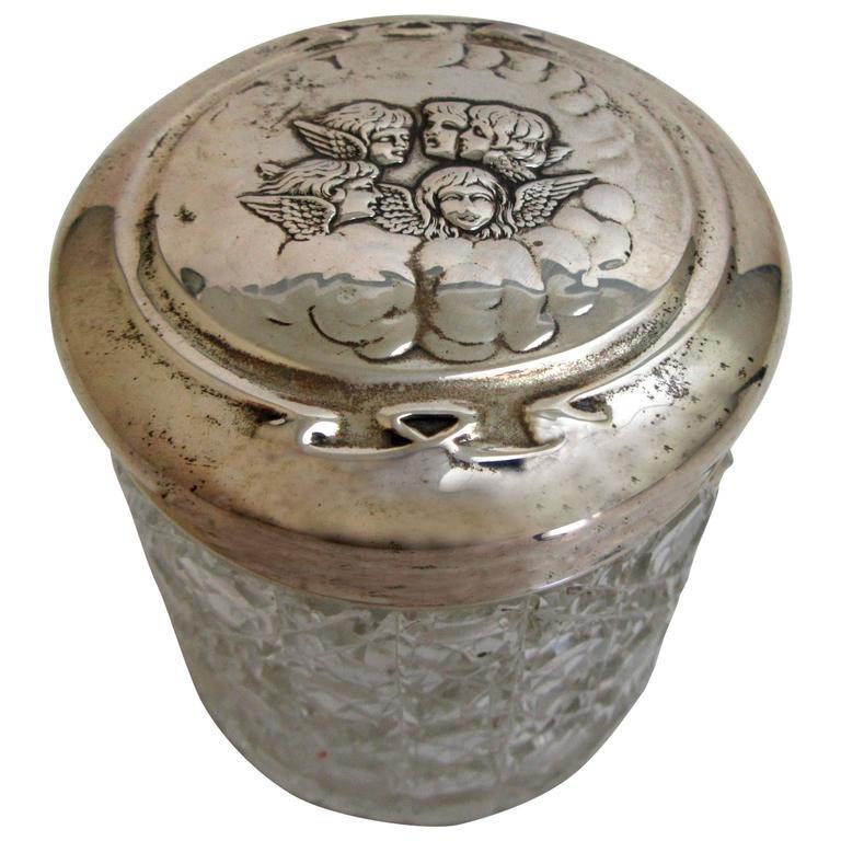 Edwardian Sterling Lidded Glass Vanity Jar of Cherub Design For Sale