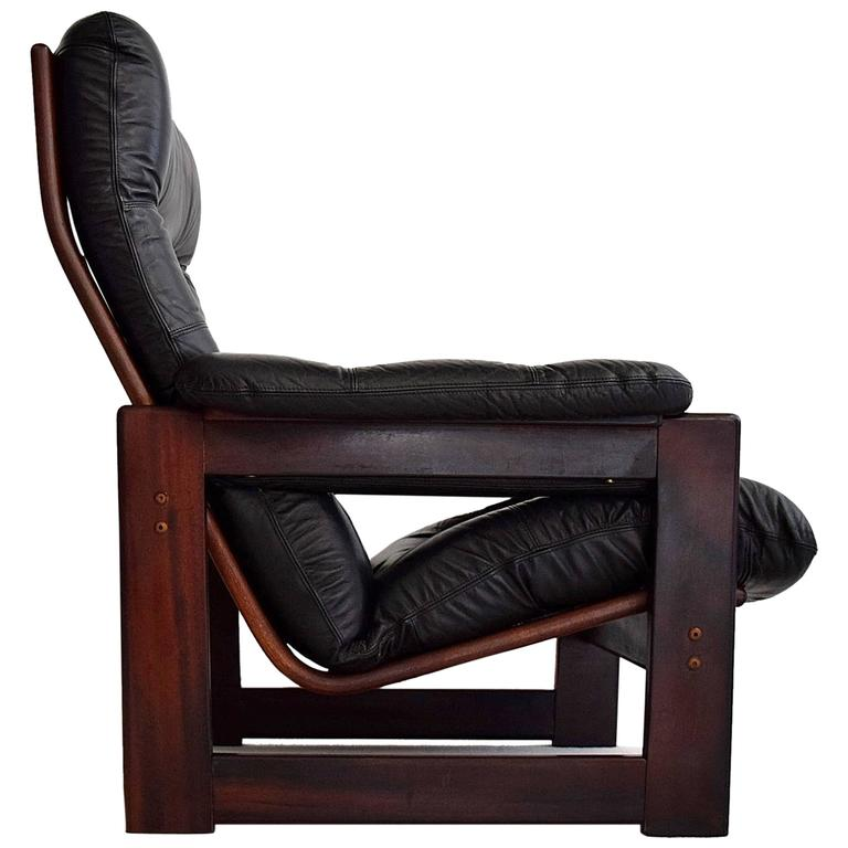 coja high back leather and mahogany lounge chair for sale