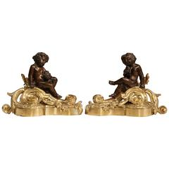 Pair of 19th Century French Gilt and Patinated Bronze Cherubs Chenets Andirons
