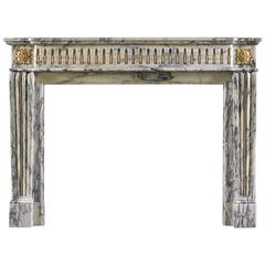 French Louis XVI Style Antique Fireplace in Elegantly Veined Arabescato Marble