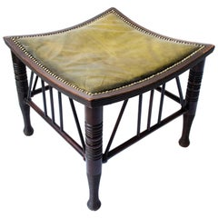 Liberty & Co A Large Size Walnut Thebes Stool with ring turned legs & stretchers