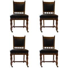 Lambs of Manchester A Set of Four Aesthetic Movement Oak & Leather Dining Chairs