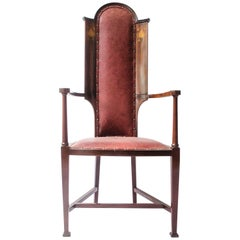 J S Henry attr. An Arts & Crafts Mahogany Armchair With Stylised Floral Inlays