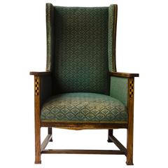 M H Baillie Scott. An Arts & Crafts Oak Lounge Chair Chequer Inlays To The Arms