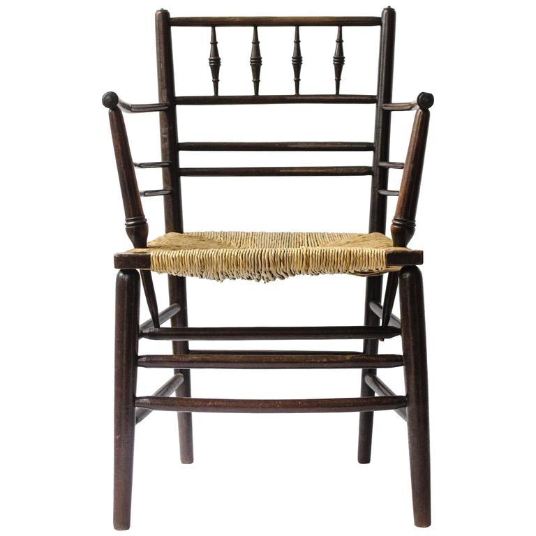 William Morris, An Arts And Crafts Ebonised Rush Seat Sussex Armchair