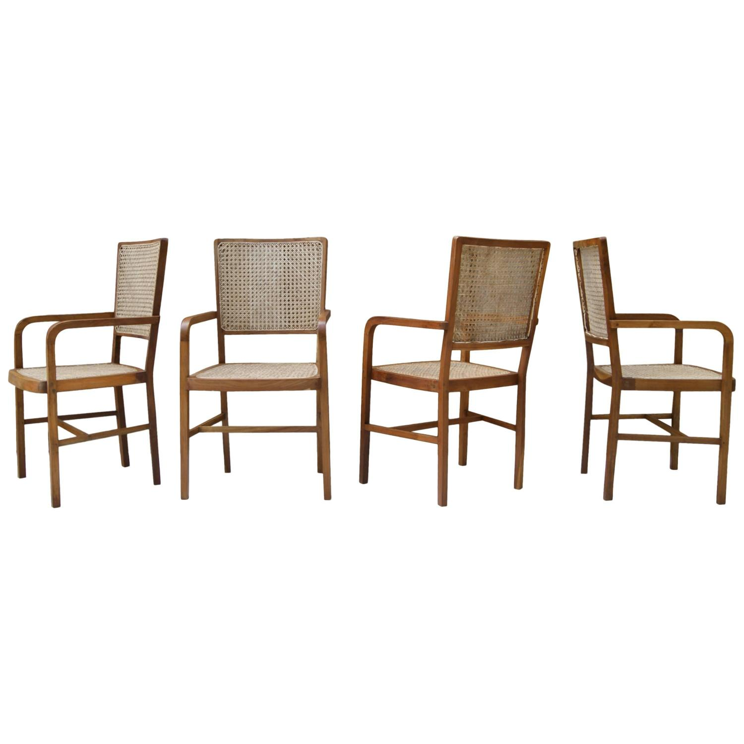 Set of four unique teak and cane south asian dining chairs for Oriental dining room furniture for sale