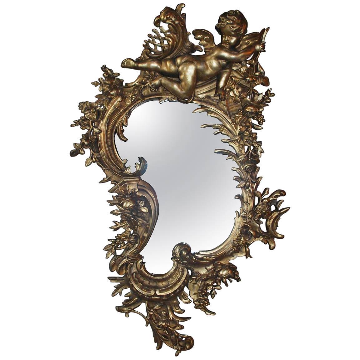 Antique 19th century Italian gold rococo wall mirror with large cherub or putti
