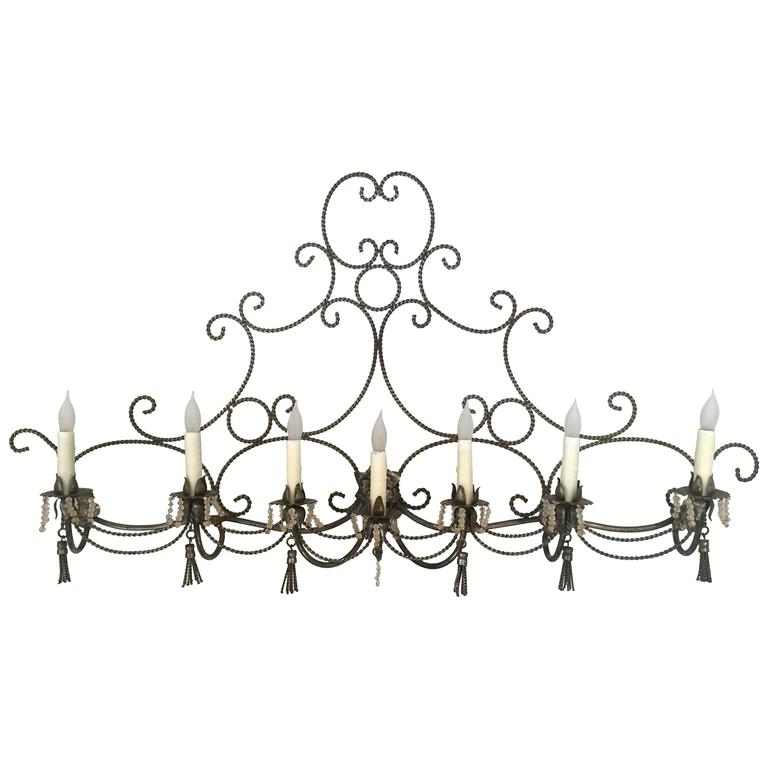 Long French Steel Six-Light Wall Sconce with Tassels and Glass Beads For Sale at 1stdibs