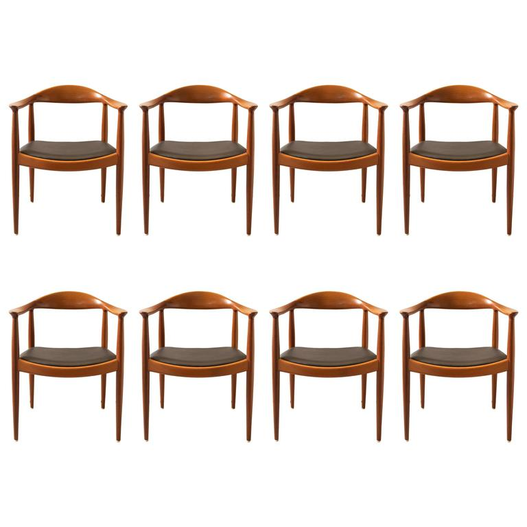 Hans Wegner Set Of Eight Round Back Dining Chairs In Mahogany And Black Leather For
