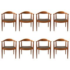 Hans Wegner, Set of Eight Round Back Dining Chairs in Mahogany and Black Leather