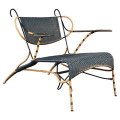 Sculptural Italian Black and Natural Wicker Chair Over a Steel Frame
