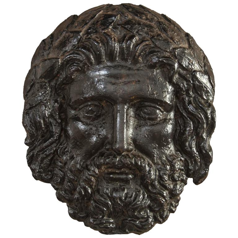 Continental Black Patinated Iron Bas-Relief Mask of Zeus For Sale
