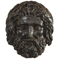 Continental Black Patinated Iron Bas-Relief Mask of Zeus
