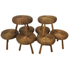Eight Rattan Stools by Tony Paul