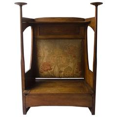 Liberty & Co. An Arts & Crafts Oak Settle in the Style of CFA Voysey