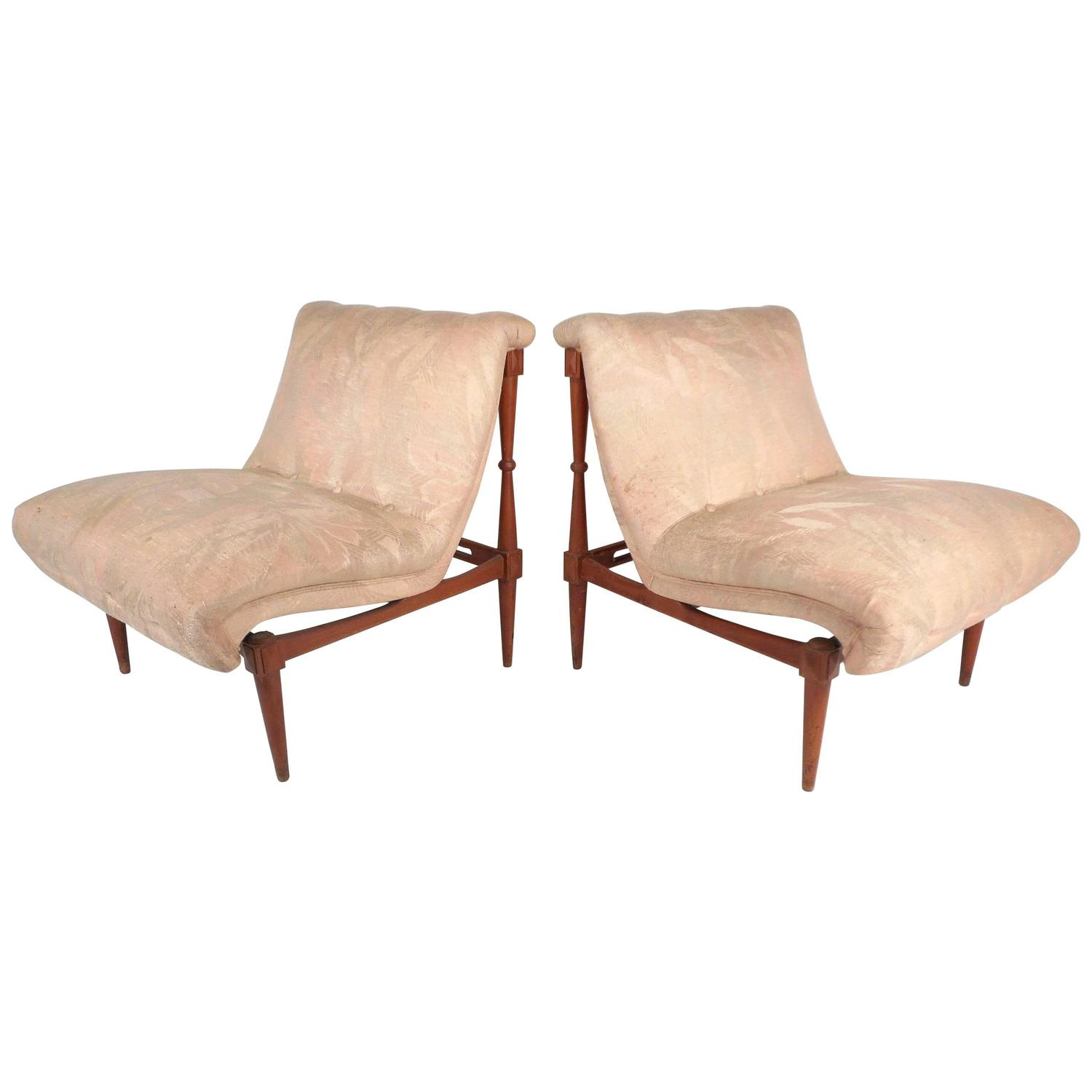 pair of mid century modern sculpted walnut slipper chairs at 1stdibs