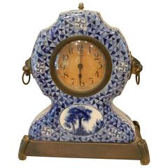 French Porcelain Clock on a Brass Base and Lion Head Handles, 20th Century