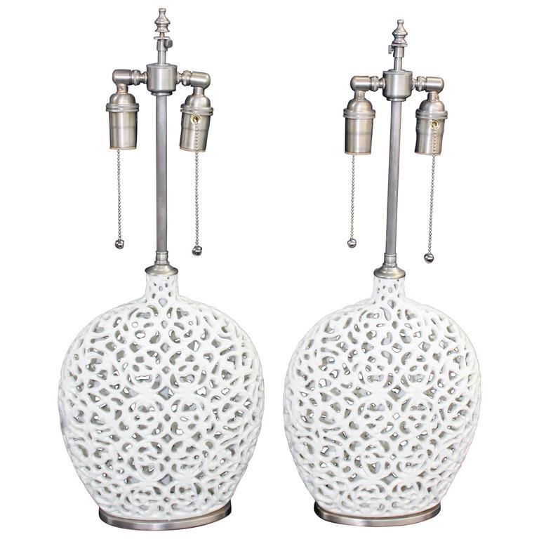 Unusual Pair of Cream Colored Ceramic Filigree Vessels with Lamp Application