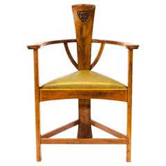 M H Baillie Scott. An Arts & Crafts Walnut Armchair with stylised floral carving