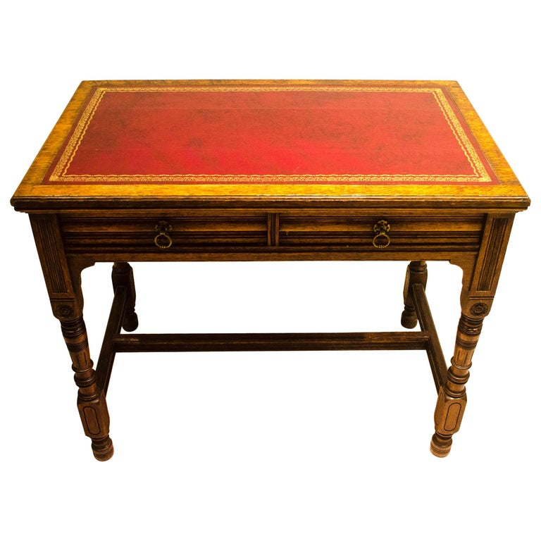 Bruce Talbert for Gillow and Co. A Gothic Revival Oak and Leather Writing Table For Sale