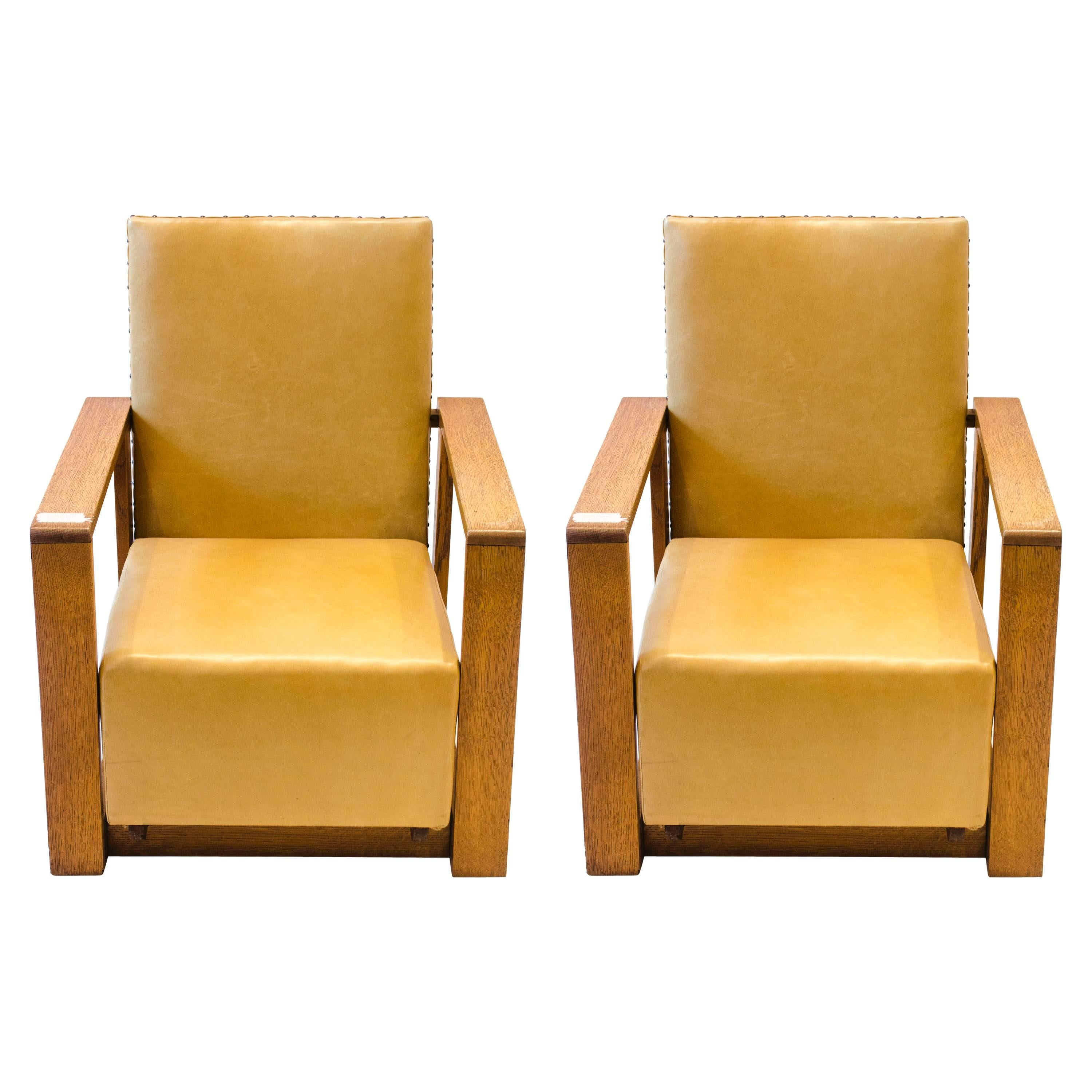 Gordon Russell, W. H. Russell. Three Arts and Crafts Oak Reclining Armchairs.