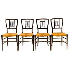 E W Godwin. A Set of Four Anglo-Japanese Ebonised Rush Seat Chairs