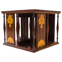Shapland & Petter. An Arts & Crafts Table Top Revolving Inlaid Bookcase