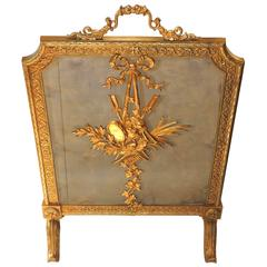 For Sale on 1stdibs - Lovely three sides folding fireplace screen with pretty bronze carved gilded decorative elements around the edge of the screen.