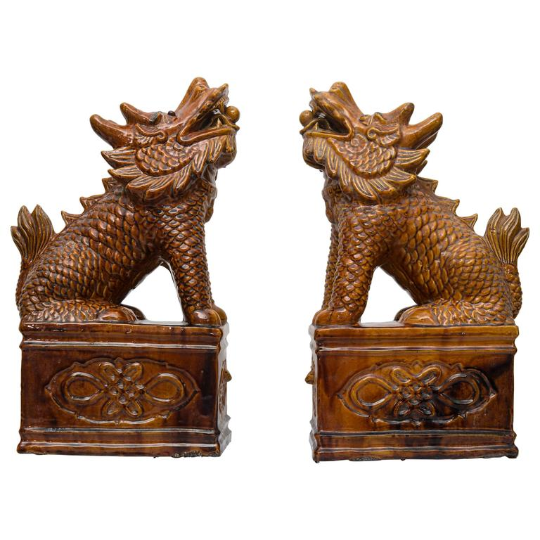 Pair of Chinese Umber Glazed Porcelain Foo Lions For Sale