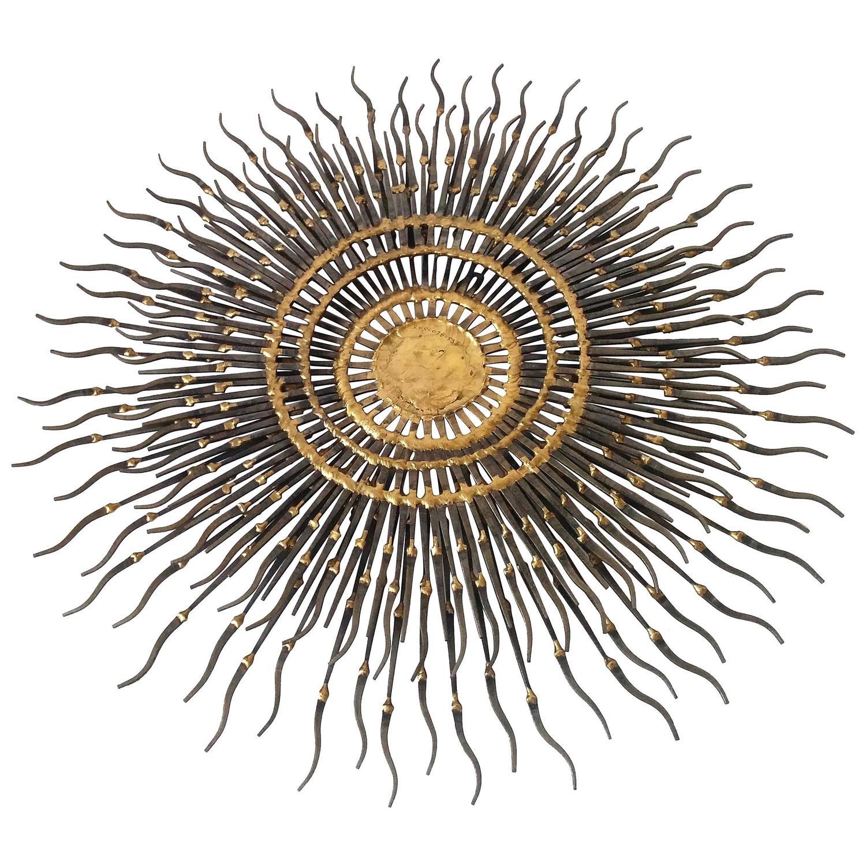 Sunburst wall art made of cut nail and brass welding for Sunburst wall art