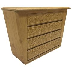 Carved Blond Wood Four-Drawer Chest