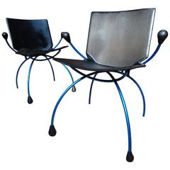 Two Blue Metal Framed 'Spider' Chairs