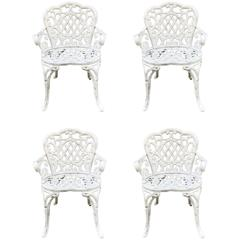 Set of Four Early Cast Iron Garden Chairs