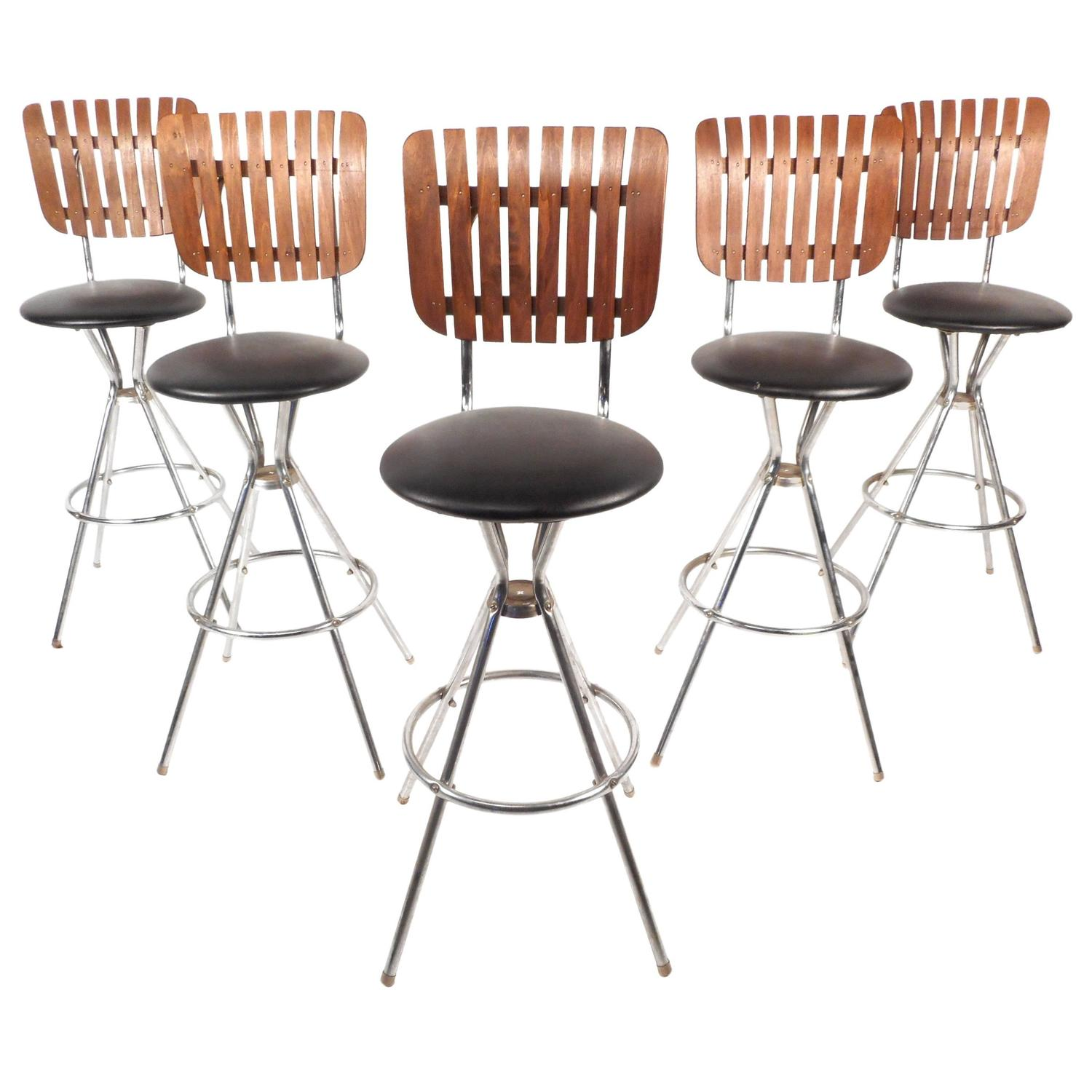 Set of five mid century modern swivel bar stools for sale at 1stdibs