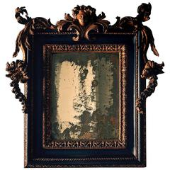 Baroque Italian Carved Giltwood and Ebonised Mirror Roman Late 17th Century