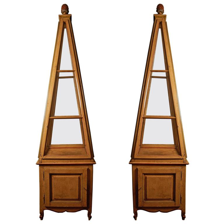 A pair of Belle Epoque polychrome-painted obelisk display vitrines, circa 1900