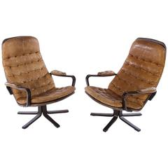 Pair of Mid-Century Swivel Chairs