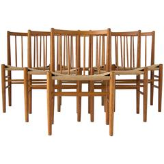 Six Spindle-Backed Oak and Danish Cord Dining Chairs
