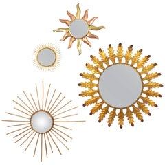 Set of Four European 20th Century Gilt Iron, Copper and Rattan Sunburst Mirrors
