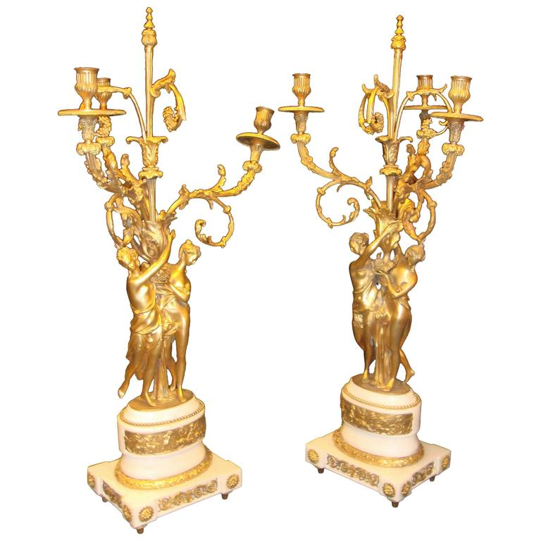 Pair of Figural Bronze Candelabras on Marble Bases